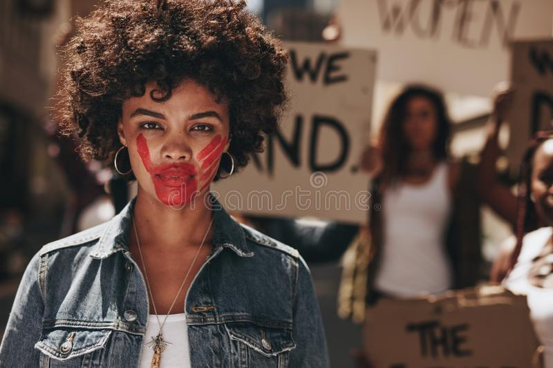 Activist demonstrating to stop women abuse royalty free stock images