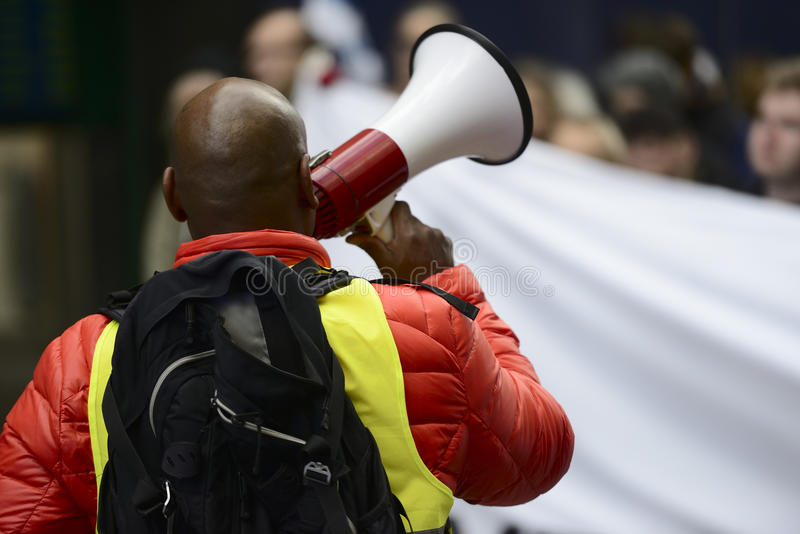 Activist with the megaphone. During a protest stock photography