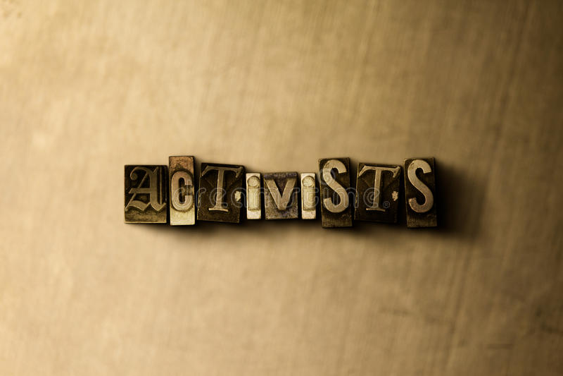 ACTIVISTAS - close-up vintage sujo da palavra typeset no contexto do metal foto de stock royalty free