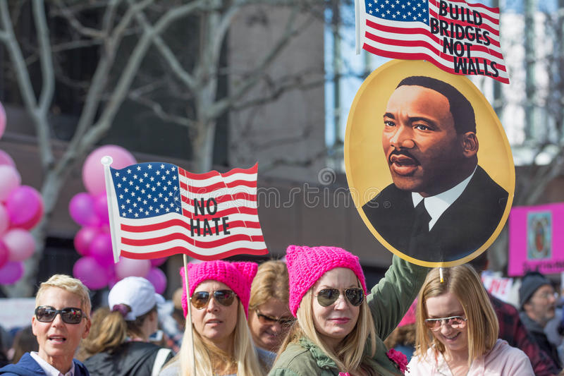 Activists with American flags and image of Martin Luter King stock image