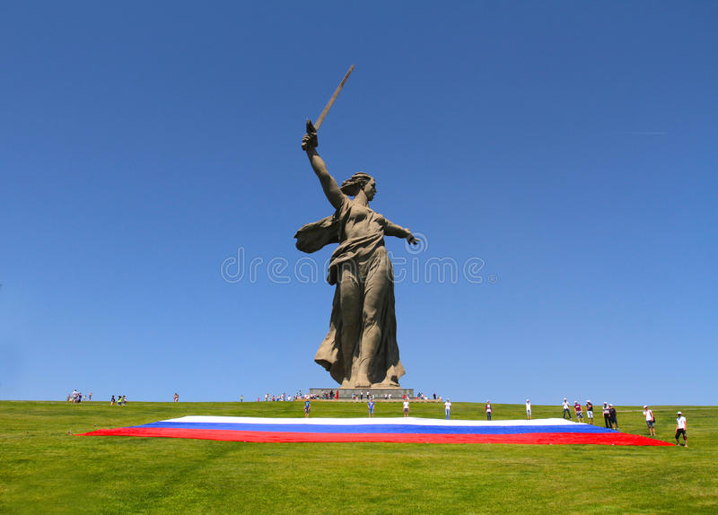 Activists unfurl a large Russian flag in Day of Russia on Mamaev hill in Volgograd royalty free stock photo