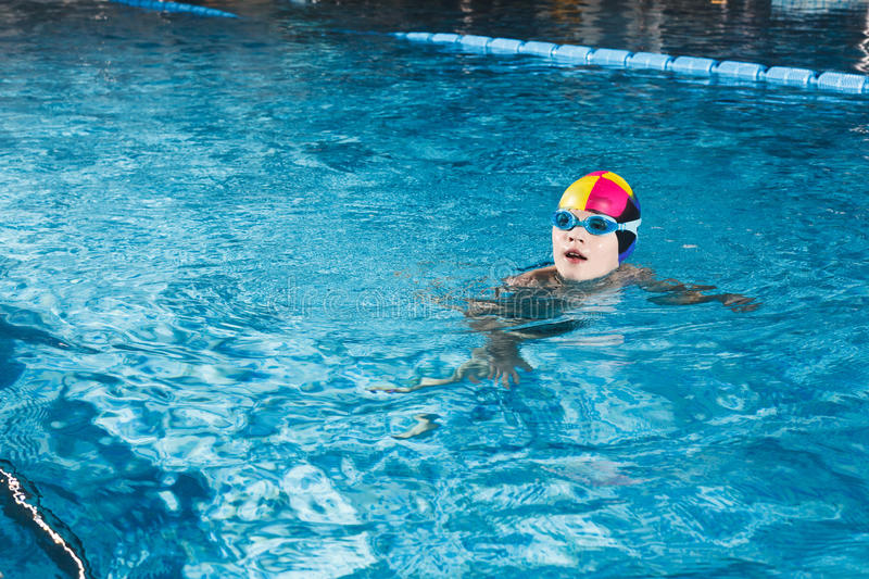Activities on the pool young boy swimming fitness royalty free stock photography