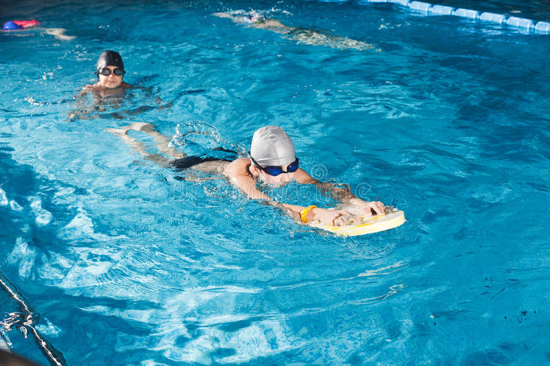 Activities on the pool young boy swimming fitness stock photography