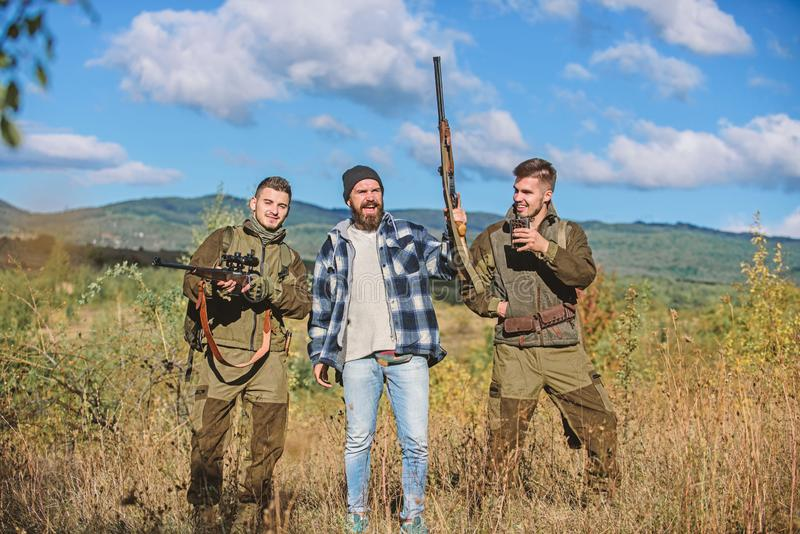 Activity for real men concept. Hunters gamekeepers looking for animal or bird. Hunters with rifles in nature environment stock images