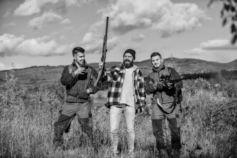 Activity for real men concept. Hunters gamekeepers looking for animal or bird. Hunters with rifles in nature environment royalty free stock photo