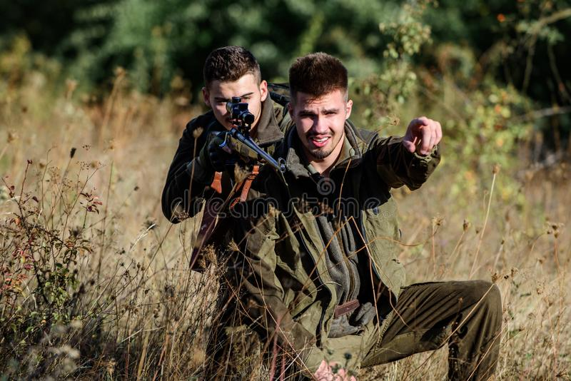 Activity for real men concept. Hunters with rifles in nature environment. Hunters gamekeepers looking for animal or bird stock photos