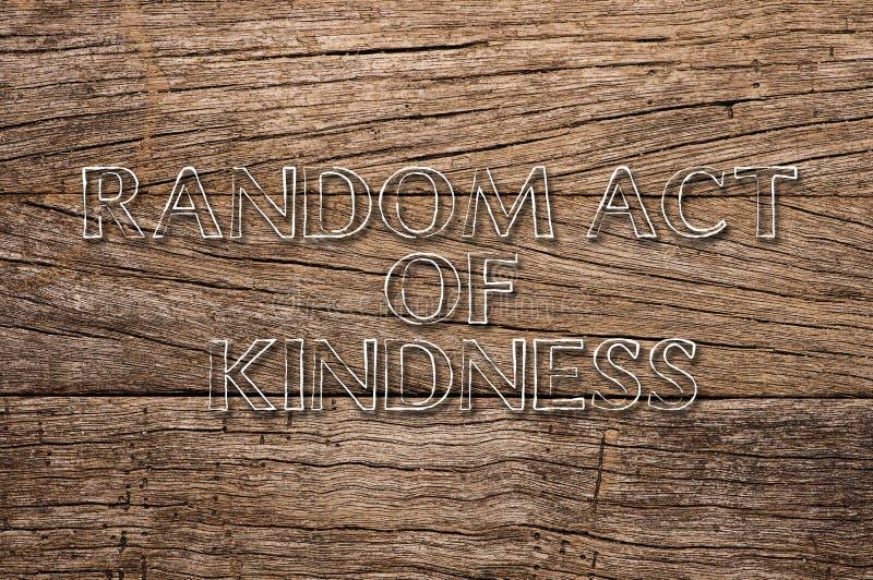 Acto al azar de la amabilidad escrito en fondo de madera foto de archivo libre de regalías
