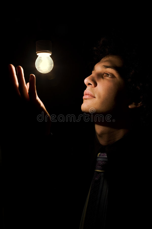 Actor. A young actor taking a pose in stage lighting stock photos