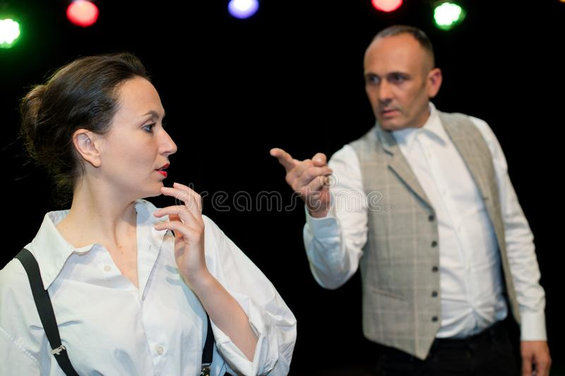 Actor and actress on stage. Playing royalty free stock photography