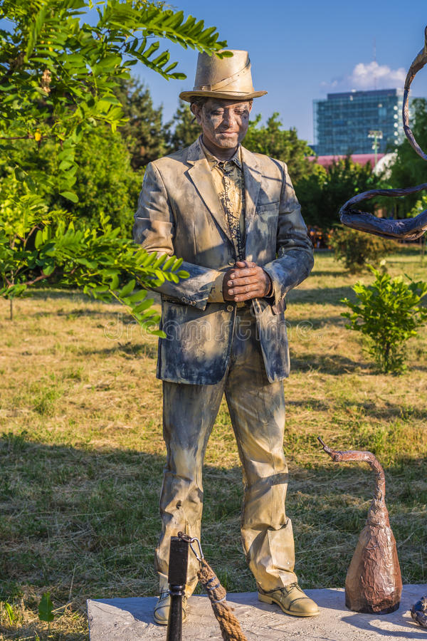 Actor as living statue stock image