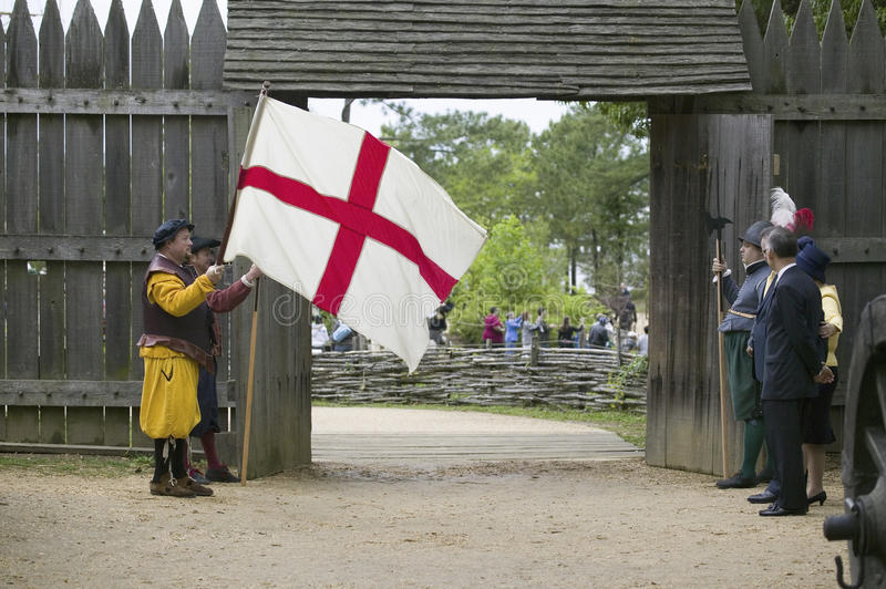 Actor holding English Flag. Bearing the Cross of St. George at gates of James Fort, Jamestown Settlement, re-creation of the first English Colony in the New stock images