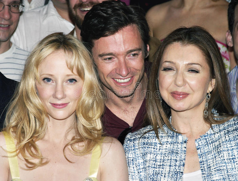 Actor Hugh Jackman is happy to be sandwiched between actresses Anne Heche and Donna Murphy. The occasion was a class picture of the Broadway Tony nominees of royalty free stock image