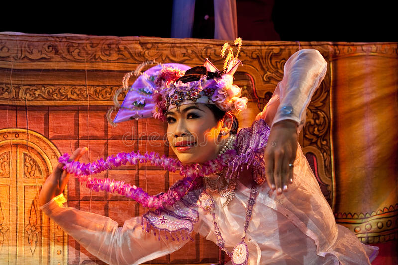 Actor of Marionette Theatre, Myanmar. Girl actor during evening show in honor of Karen New Year at Mandalay Marionette Theatre on January 10, 2011 in Mandalay stock photography
