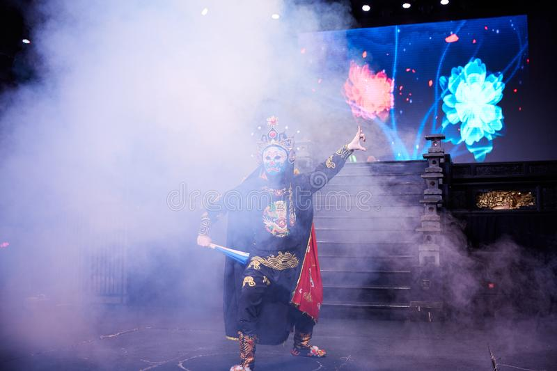 Actor performing Sichuan opera face changing royalty free stock photography