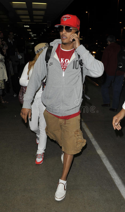 Actor/rapper T.I. is seen at LAX. LOS ANGELES-AUGUST 20: Actor/rapper T.I. is seen at LAX . August 20th in Los Angeles, California 2010 stock photography