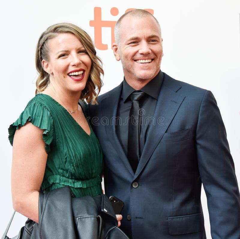 Actor Sean Carrigan at premiere of Ford V. Ferrari at TIFF film festival. Actor Sean Carrigan and his wife at premiere of Ford V. Ferrari at TIFF film festival stock photos