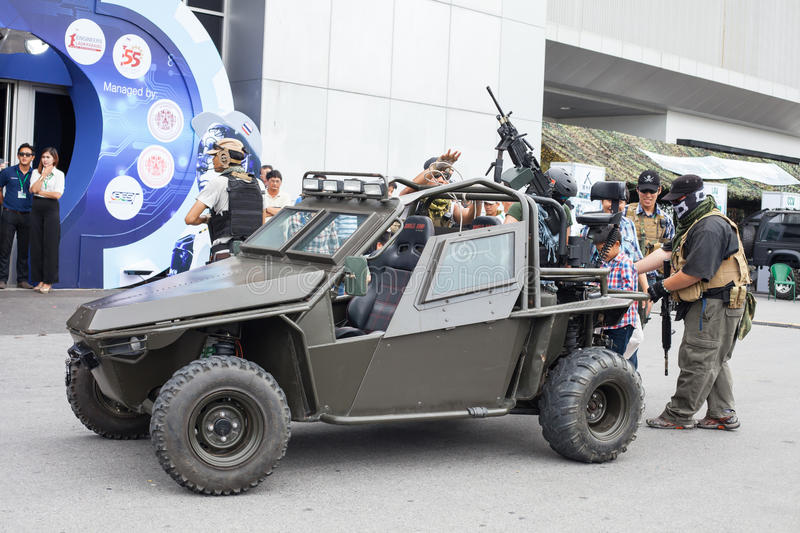 Actor show action. BANGKOK ,THAILAND - JULY 18: Unidentified actor show action with light armored vehicle in Engineering Expo 2015 , on JULY 18, 2015 in Bangkok stock photos