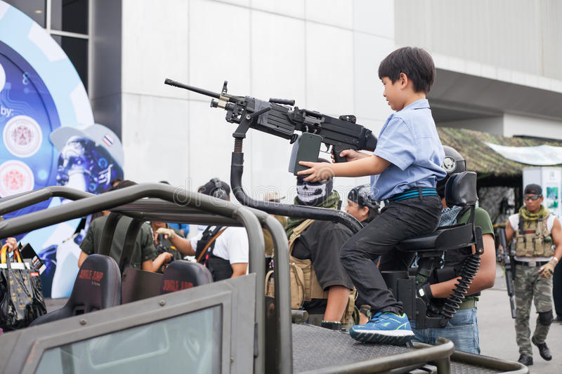 Actor show action. BANGKOK ,THAILAND - JULY 18: Unidentified actor show action with light armored vehicle in Engineering Expo 2015 , on JULY 18, 2015 in Bangkok royalty free stock photos