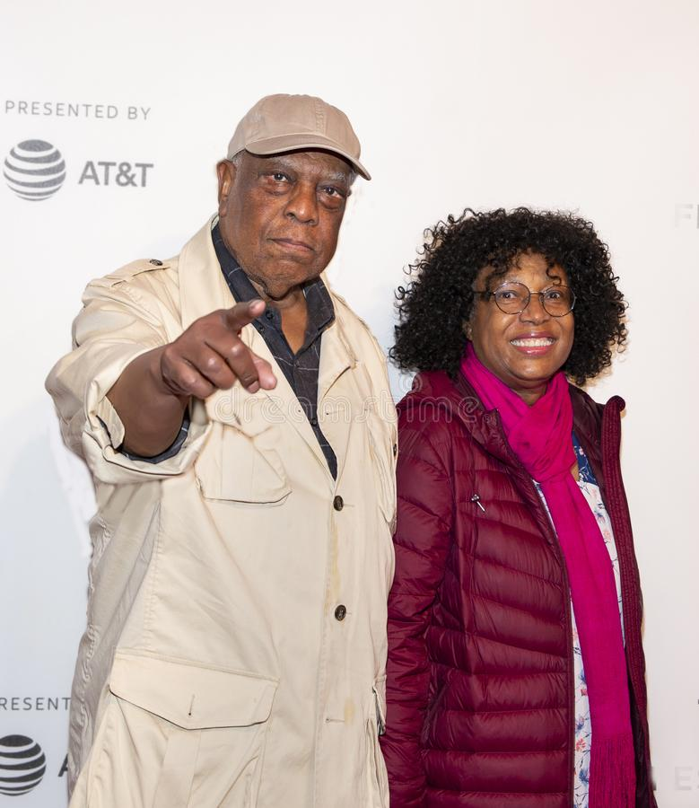 Woody King Jr. at Premiere of `It Takes a Lunatic at 2019 Tribeca Film Festival. Actor Woody King Jr. and guest arrive for the premiere of `It Takes a Lunatic` stock image