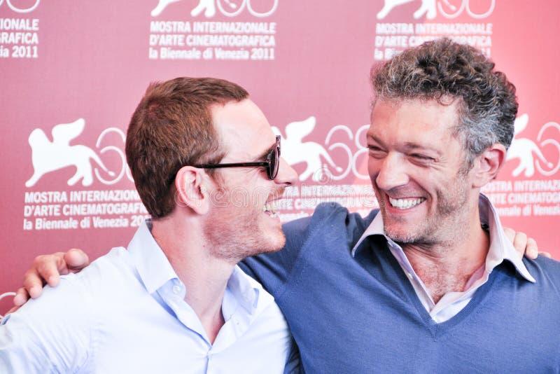 Actoren Michael Fassbender en Vincent Cassel stock fotografie