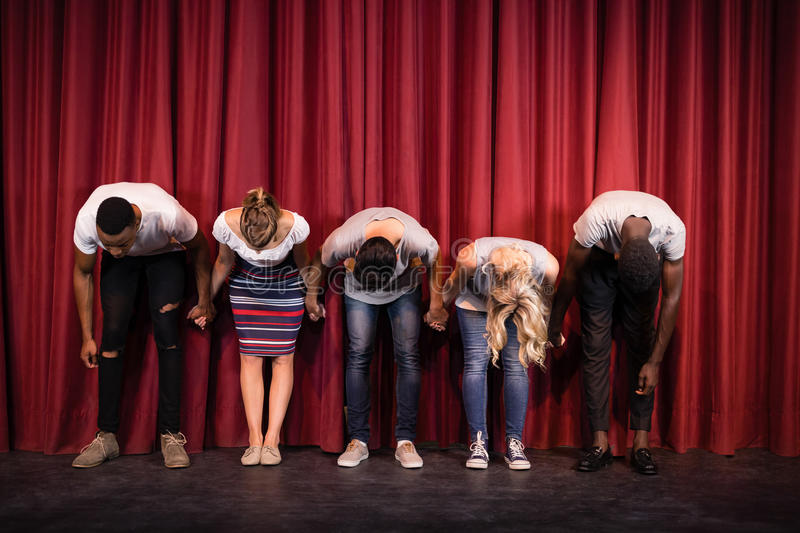 Actors bowing on the stage. In theatre royalty free stock image
