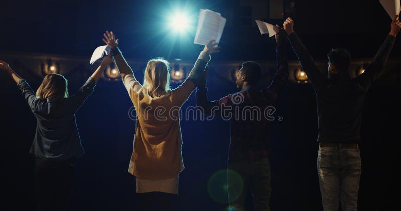 Actors bowing to audience in a theater. Slow motion of actors and actresses bowing to audience in a theater royalty free stock photos