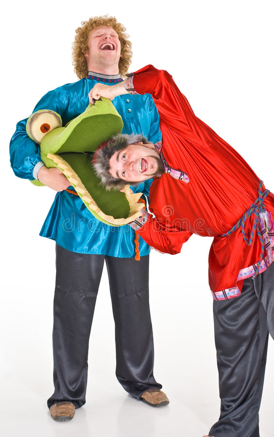 Actors in costumes. Two male actors wearing Russian folklore costumes royalty free stock image