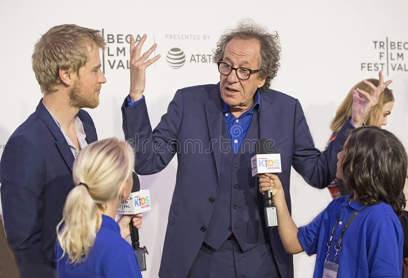 Actors Johnny Flynn and Geoffrey Rush. Oscar winner, Australian actor Geoffrey Rush arrives for the premiere of `Genius` at the 2017 Tribeca Film Festival royalty free stock images
