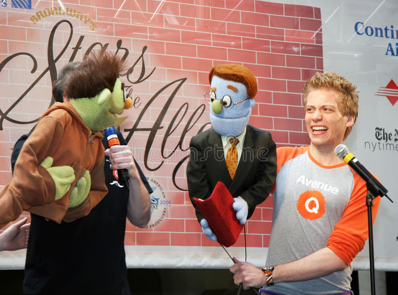 Actors and puppets from Avenue Q. Puppets steal the show from the actors in the Broadway play, Avenue Q. This brief excerpt from one of the musical comedy's stock photo