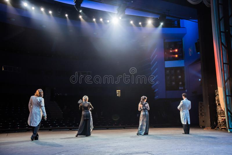 Actors on stage during a performance or rehearsal in the theater. The stage of the theatre or the Opera, with lighting equipment. Saratov / Russia - December 13 royalty free stock images