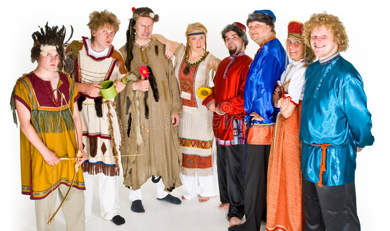 Actors in various costumes. Actors and actresses dressed in Russian folklore & shaman costumes royalty free stock image