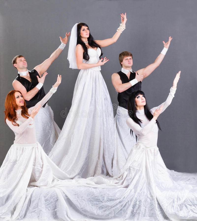 Actors in the wedding dress posing. royalty free stock images