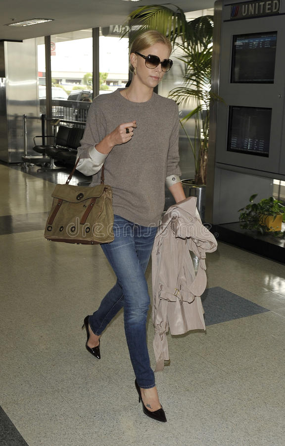 Actress Charlize Theron is seen at LAX stock photos