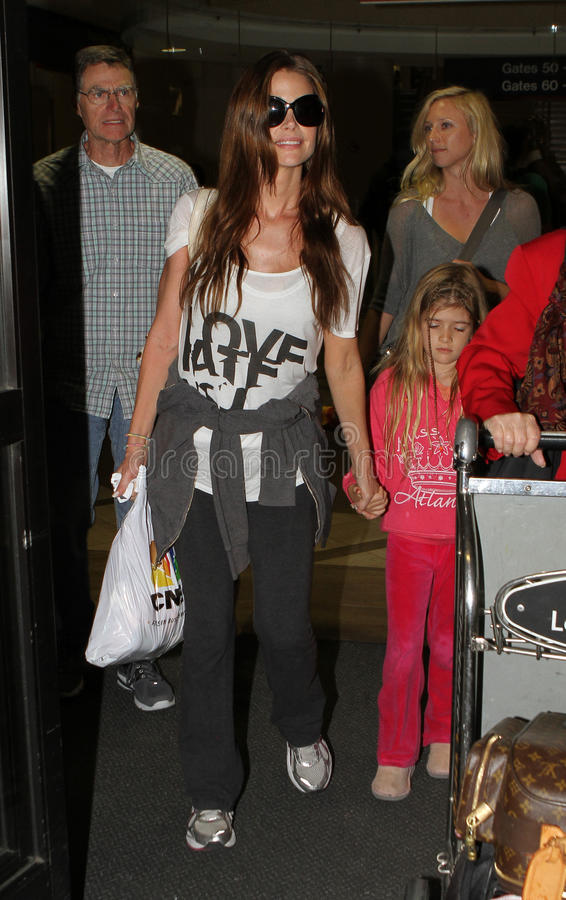 Actress Denise Richards daughter & father at LAX. LOS ANGELES-APRIL 06: Actress Denise Richards with daughter and father at LAX airport. April 06 in Los Angeles stock images