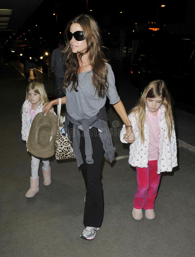 Actress Denise Richards with daughters at at LAX. LOS ANGELES-MARCH 30: Actress Denise Richards at LAX airport. March 30 in Los Angeles, California 2011 royalty free stock images