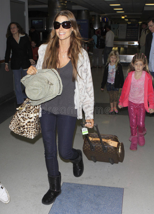 Actress Denise Richards and daughters seen at LAX. LOS ANGELES - JANUARY 1: Actress Denise Richards and daughter seen at LAX . January 1st 2011 in Los Angeles royalty free stock photos