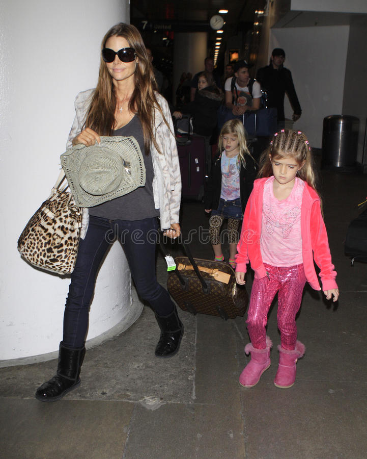 Actress Denise Richards and daughters seen at LAX. LOS ANGELES - JANUARY 1: Actress Denise Richards and daughter seen at LAX . January 1st 2011 in Los Angeles stock photography