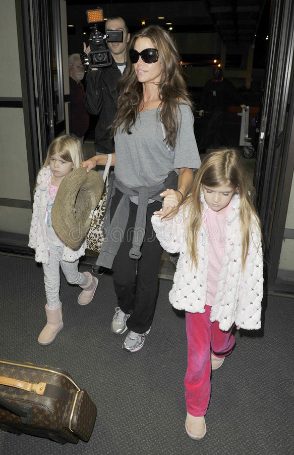 Actress Denise Richards ex of Charlie Sheen at LAX. LOS ANGELES-MARCH 30: Actress Denise Richards ex wife of Charlie Sheen with daughters at LAX airport. March royalty free stock image