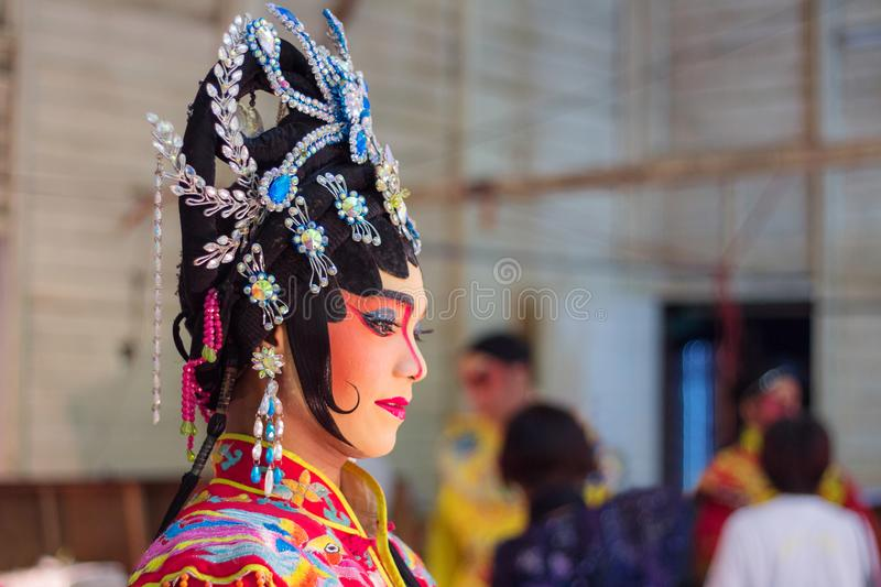 Actress makeup for Chinese opera in traditional dress. Chinese opera is an ancient drama in musical way royalty free stock photography
