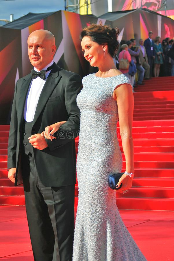 Actress Olga Kabo with her husband pose for photos. Actress Olga Kabo with her husband pose for photos at XXXV Moscow International Film Festival red carpet royalty free stock photography
