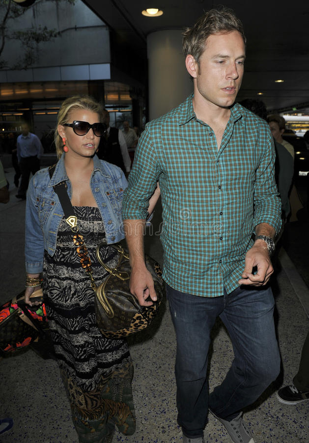 Actress Singer Jessica Simpson & boyfriend at LAX royalty free stock photo