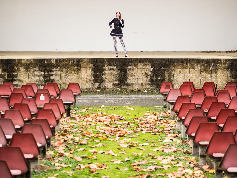 Actress on the stage. Alone actress stands at the stage with no audience royalty free stock image