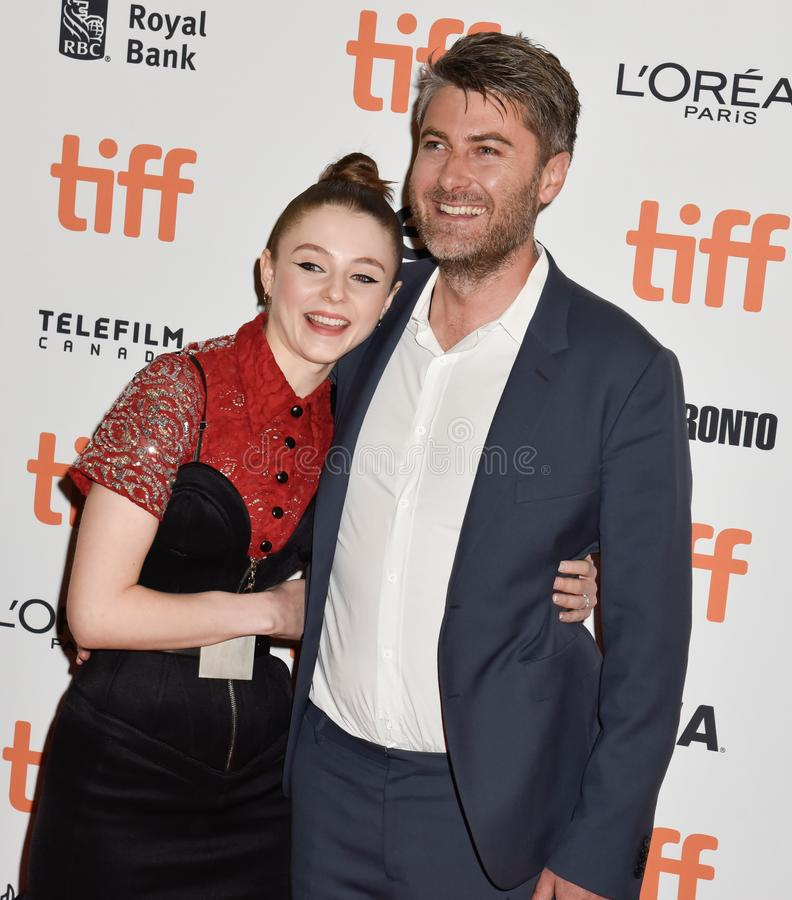 Actress Thomasin McKenzie and producer Carthew Neal at premiere of Jojo Rabbit at TIFF. Thomasin McKenzie at premiere in toronto for Jojo Rabbit movie film stock photography