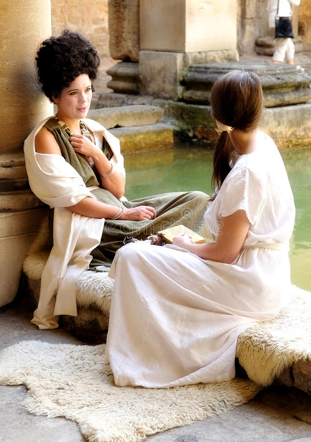 Actresses in costume at Roman Baths, Bath, England stock images