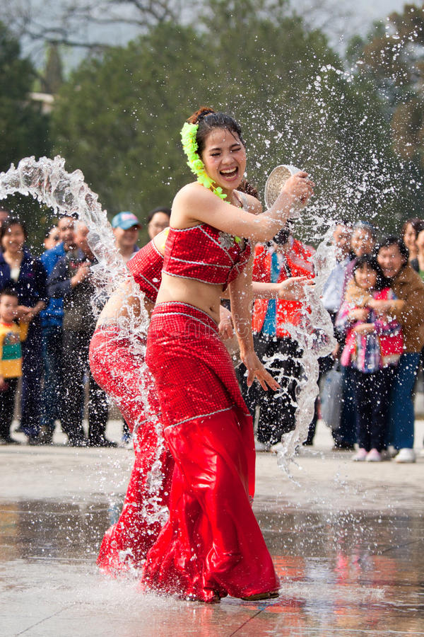 Actresses performing in the water-splashing festival stock images