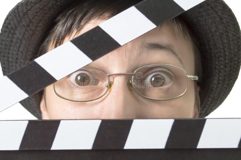 Actrice avec le clapet de film derrière le visage images stock