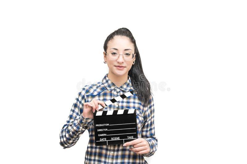 Actriz sonriente del adolescente con el tablero de chapaleta de la película imágenes de archivo libres de regalías