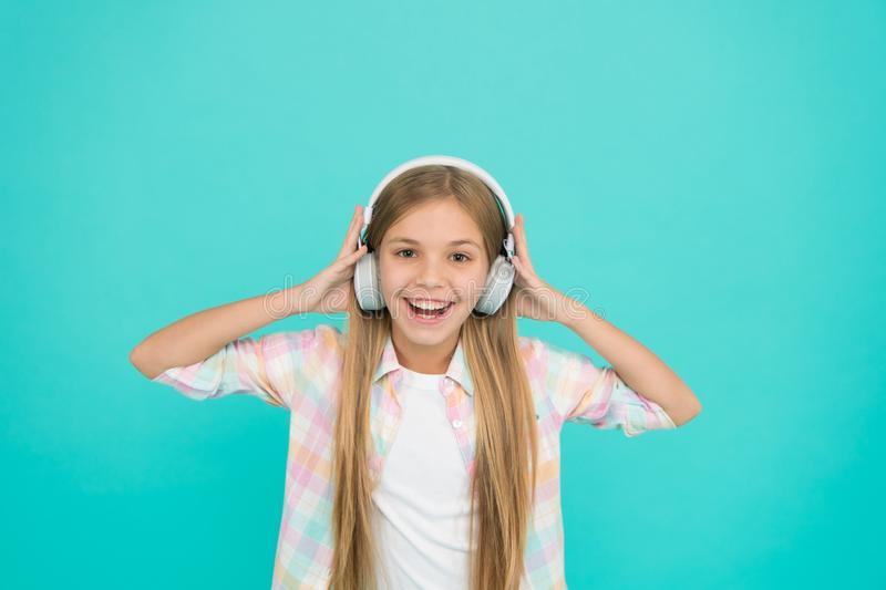 She is actually a big music fan. Happy little child enjoy music playing in headphones. Little girl child listening to. Music. Adorable music lover. makes her royalty free stock photo