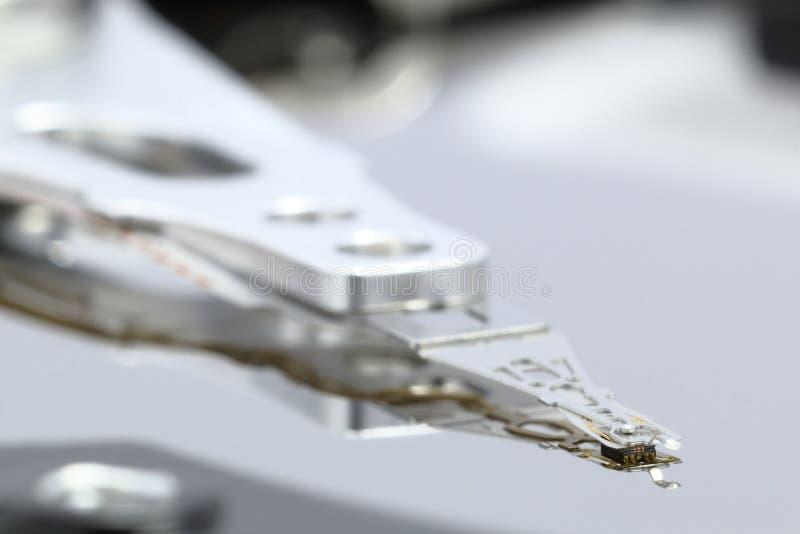 Actuator van de stemrol wapen met magnetisch hoofd binnen HDD stock fotografie