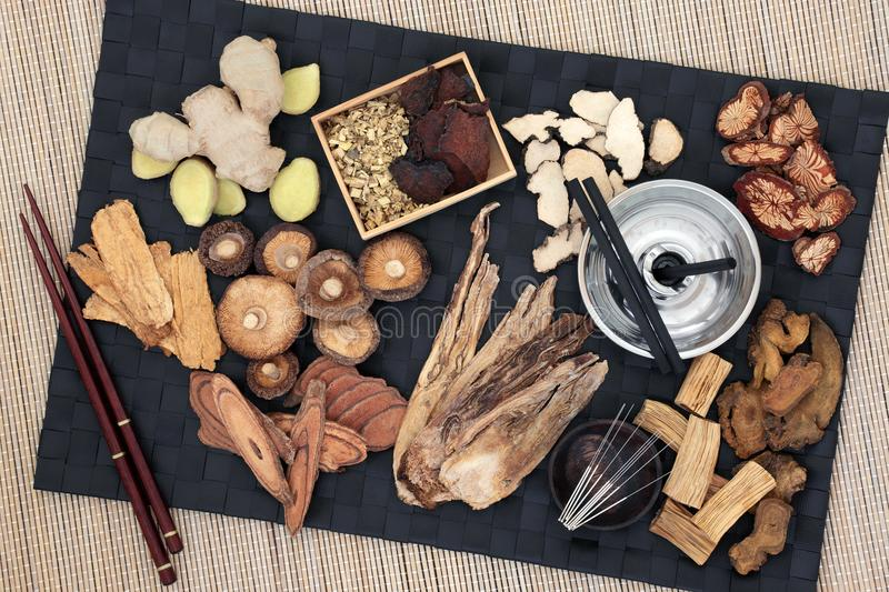 Acupuncture and Moxibustion Therapy. Chinese alternative medicine with herbs, acupuncture needles and moxa sticks used in moxibustion therapy. Top view royalty free stock photos